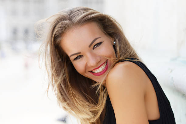 Happy young brunette carefree woman smiling outdoor portrait, happiness
